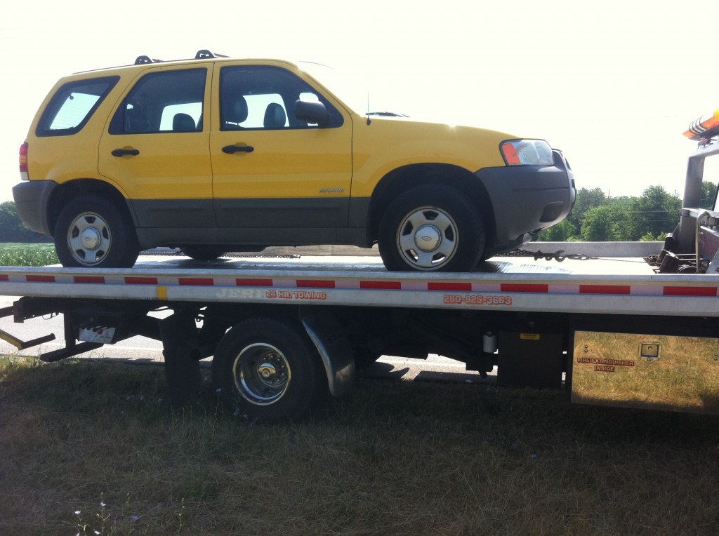 Yellow Ford Escape Being Towed