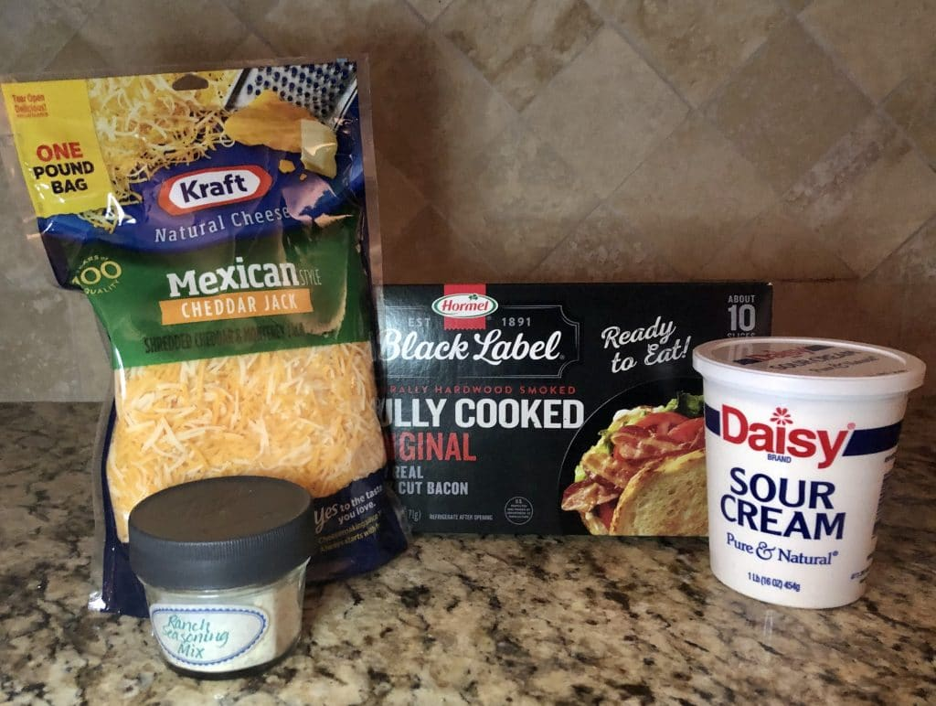 Picture of Mexican Shredded Cheese, Homemade Ranch Seasoning Mix, Cooked Bacon and Sour Cream to make Bacon Ranch Cheddar Dip