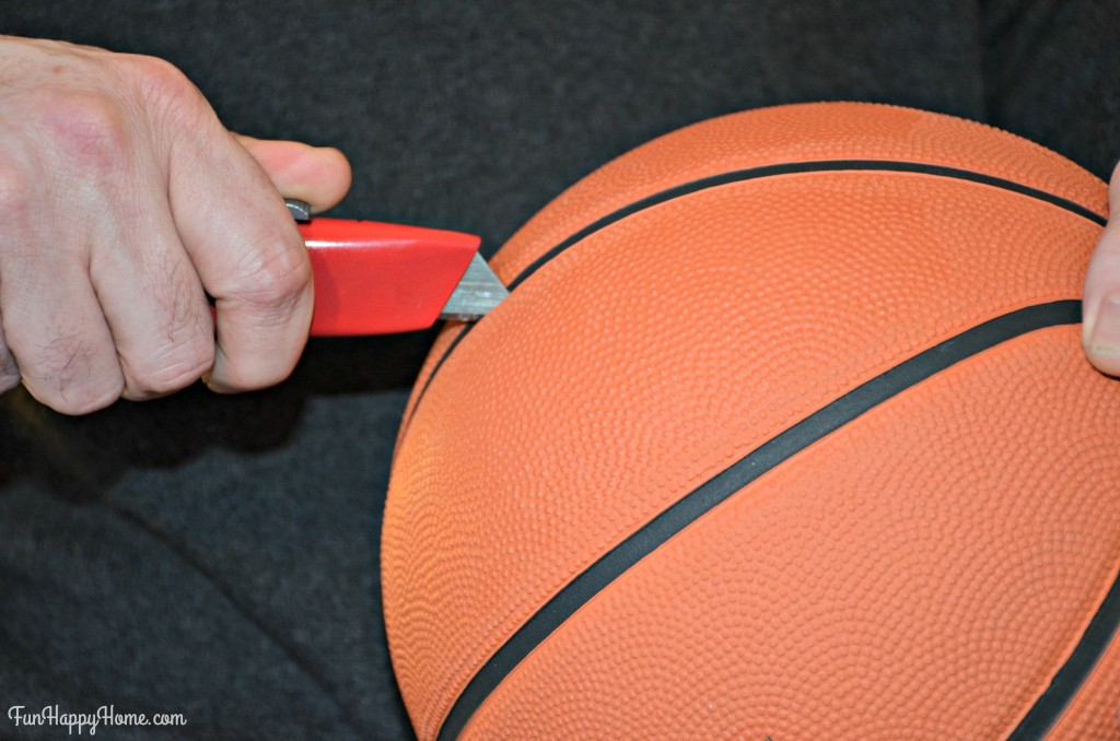 Cutting the basketball for Basketball Candy Bouquet