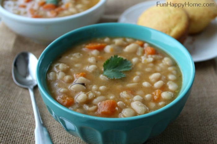 Navy Bean Soup Recipe is a great slow cooker meal that comes together in no time. It is so easy, frugal, and delicious! A great slow cooker soup!