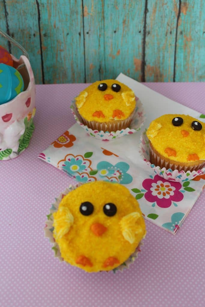 adorable Easter chick cupcakes with buttercream frosting and yellow sugar sprinkles