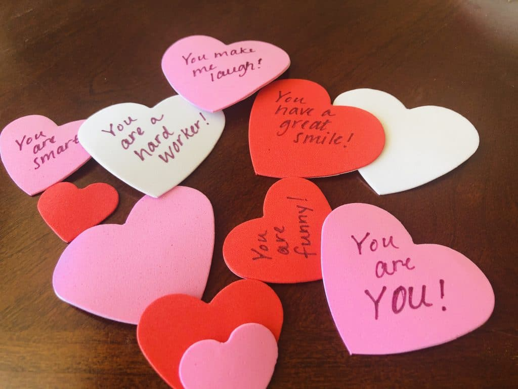 foam hearts with words of affirmation written on them for a DIY Valentine's day gift that double as valentines day decor
