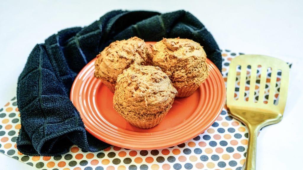 Pumpkin Muffins on an orange plate. These 2 ingredient pumpkin muffins were made in an air fryer.