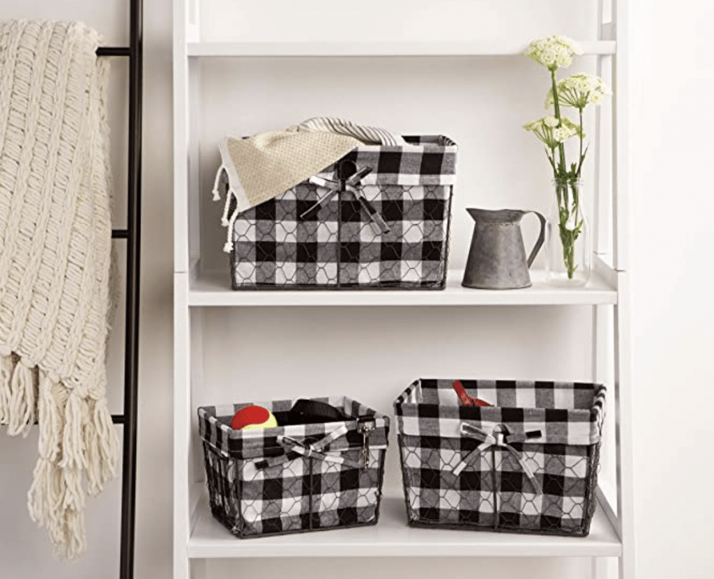Vintage Chicken Wire baskets with buffalo check fabric set on a cute shelf! A perfect example of adorable farmhouse decor!