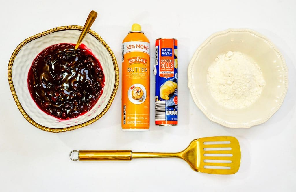 Ingredients for Air Fryer Blueberry Dessert. This Air Fryer Blueberry Dessert is made with crescent rolls, blueberry pie filling, cooking spray and powdered sugar and is made in the Air Fryer.